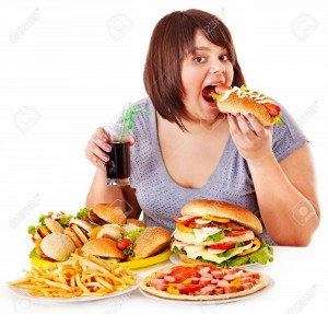 15231877-overweight-woman-eating-fast-food-junk