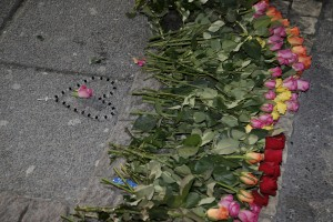 Flowers are seen placed at the scene of a fatal shooting in Gothenburg